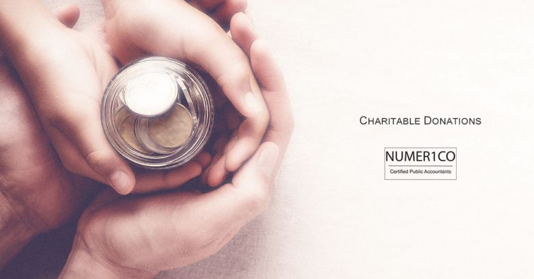 Hands holding coins in a jar. Numerico | Charitable Donations Tax