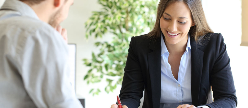 Professional business woman signing paperwork - Numerico